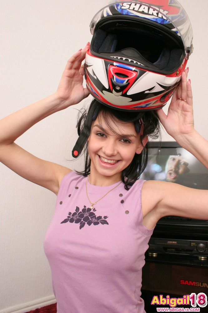 Unbelievable Sexy 18 Year Old Abigail Posing With A Big Helmet - Picture 2